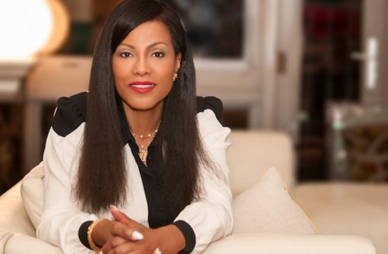 Photo of Ilyasah Shabazz with a blurred home setting in the background